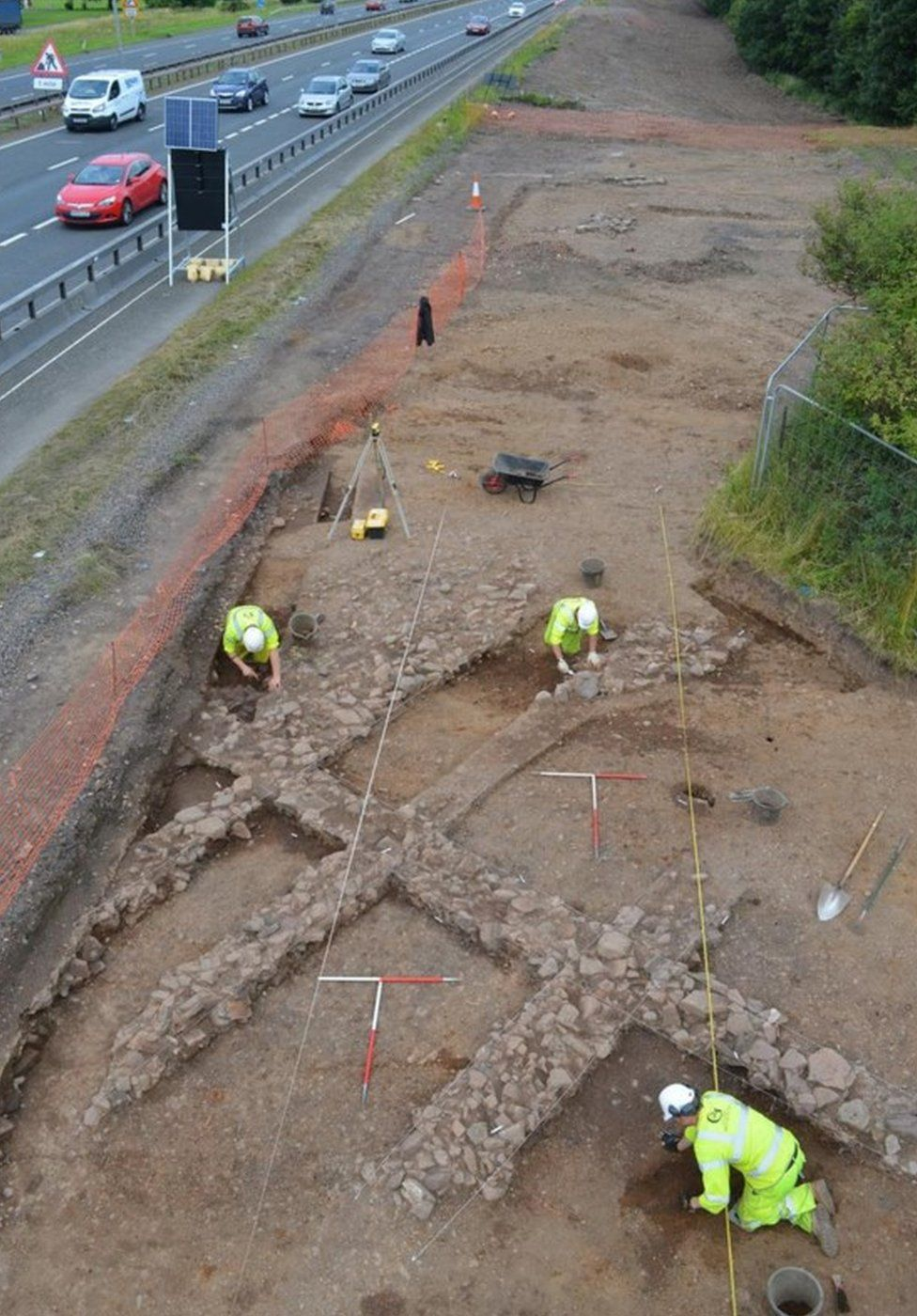 Archaeologists at the site near the M74