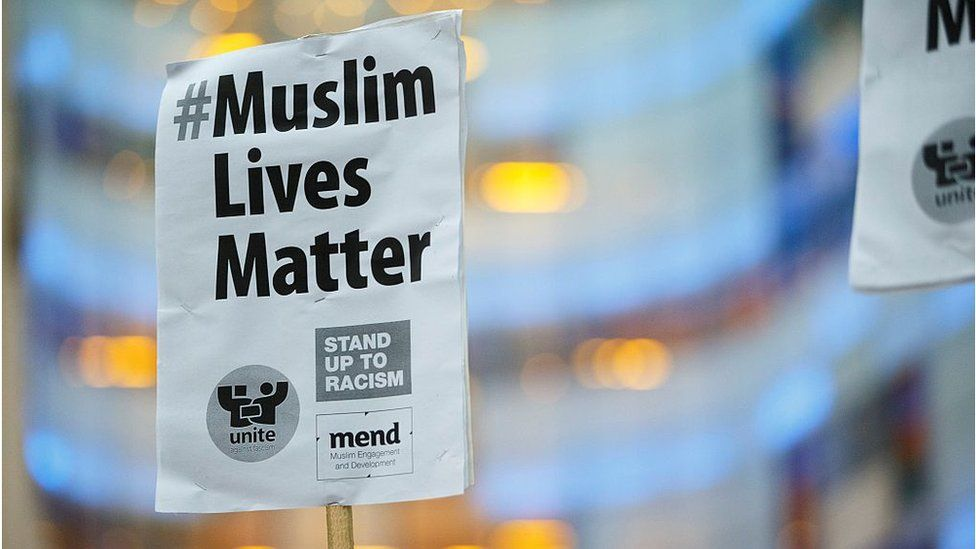 Stand up to racism placard