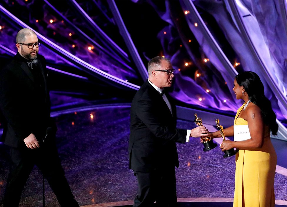 Mindy Kaling presents an Oscar to Josh Cooley and Mark Nielsen
