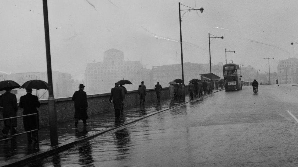 People crossing Waterloo Bridge in 1956