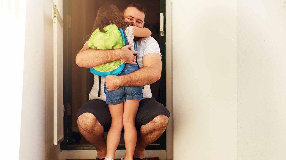 Divorced dad hugging kid