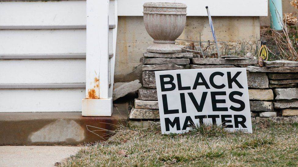 A Black Lives Matter sign sits in a front yard of a house in Evanston, Illinois, on March 16, 2021