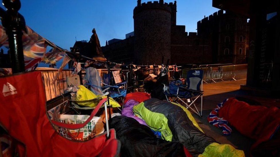 Royal fans sleep on the pavement outside Windsor Castle