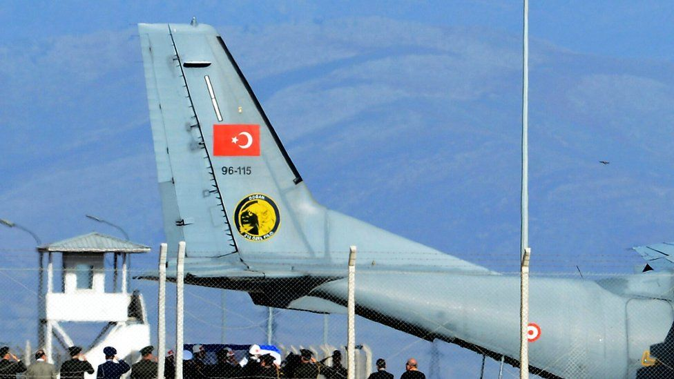 Turkish honour guard carries coffin of Russian pilot into a Turkish Air force transport plane at Hatay airport, 29 Nov 2015.