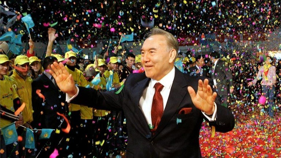 FILE PHOTO: Kazakh President Nursultan Nazarbayev waves to supporters after his victory in the presidential election was officially announced in Astana, Kazakhstan December 5, 2005.