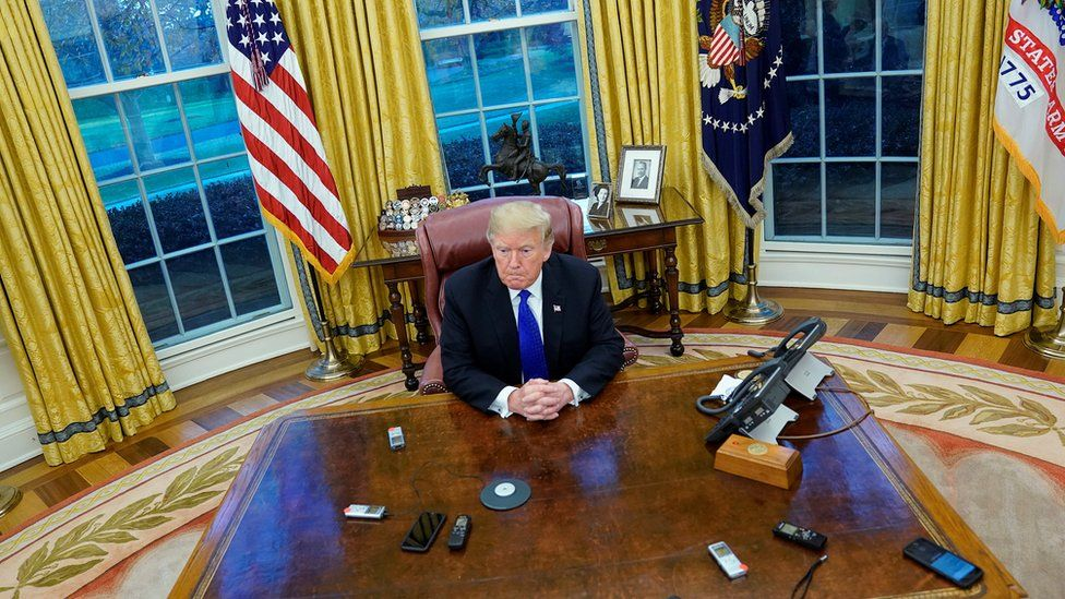 U.S. President Donald Trump answers questions during an exclusive interview with Reuters journalists in the Oval Office at the White House in Washington, U.S. December 11, 2018.
