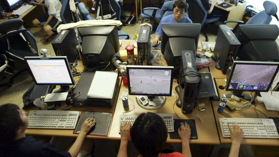 Professional gamers of Pantech and Curitel team practice at their dormitory on August 11, 2005 in Seoul, South Korea.