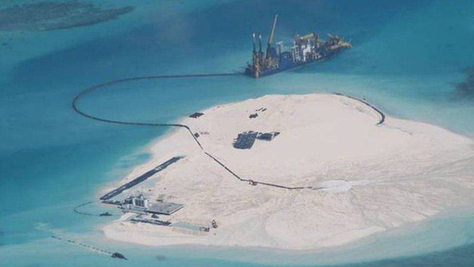 Chinese vessel, top centre, is used to expand structures and land on the Johnson Reef, called Mabini by the Philippines and Chigua by China, at the Spratly Islands