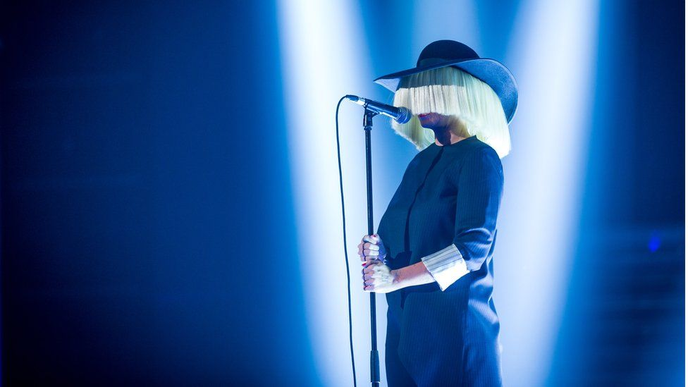 Sia performing on stage