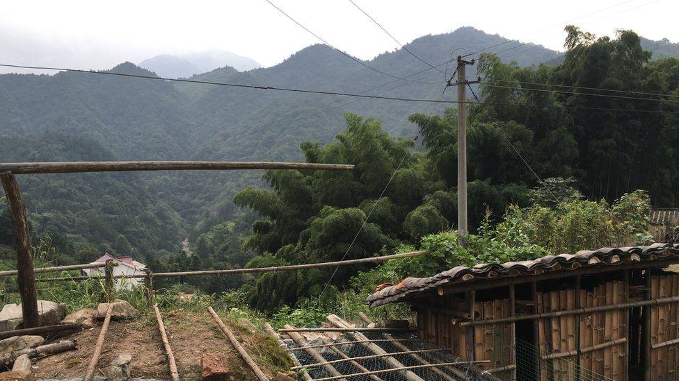 Chicken pen in the village overlooking the valley