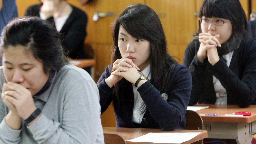 Students prepare themselves to begin eight hours of back to back exams