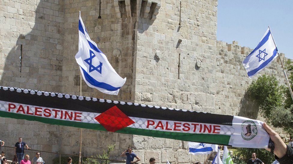 Israel flags and a Palestinian scarf