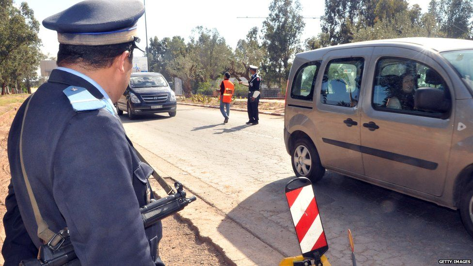 A police officer watches traffic in Marrakesh, 2011