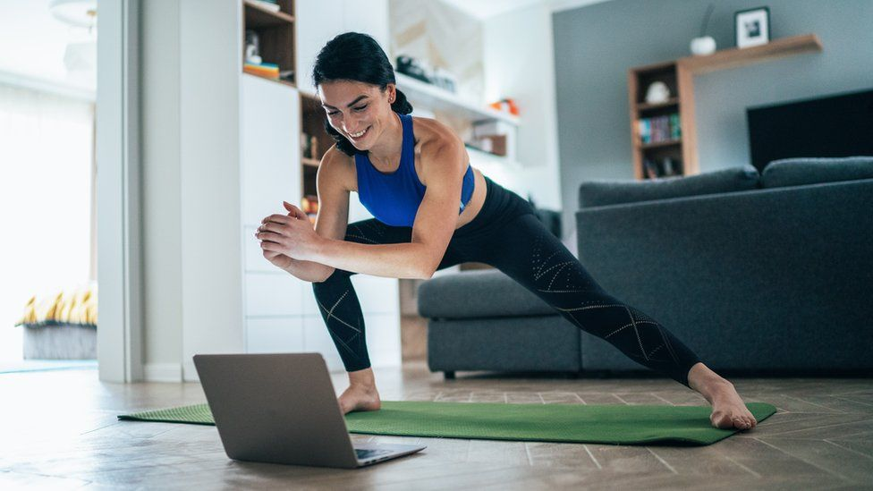 A woman leading a home-workout class