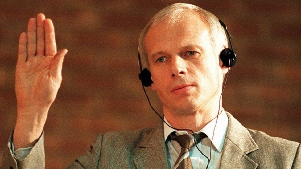 In this 24 November 1997 convicted killer Janusz Walus is sworn in during a Truth and Reconciliation Commission hearing in Mamelodi, South Africa