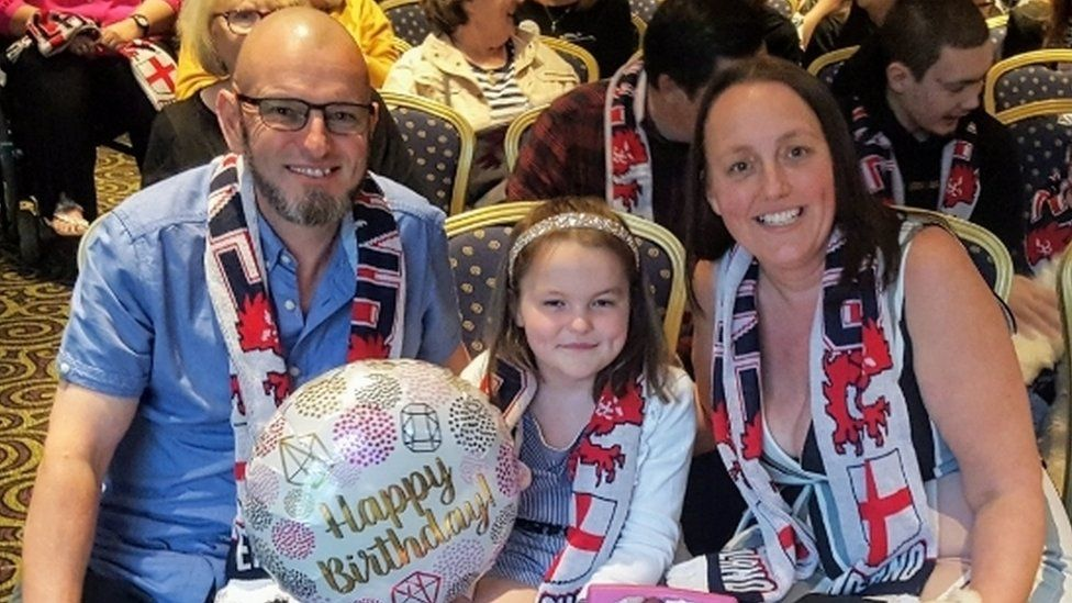 Paige Brindle with her parents Terry and Tanya
