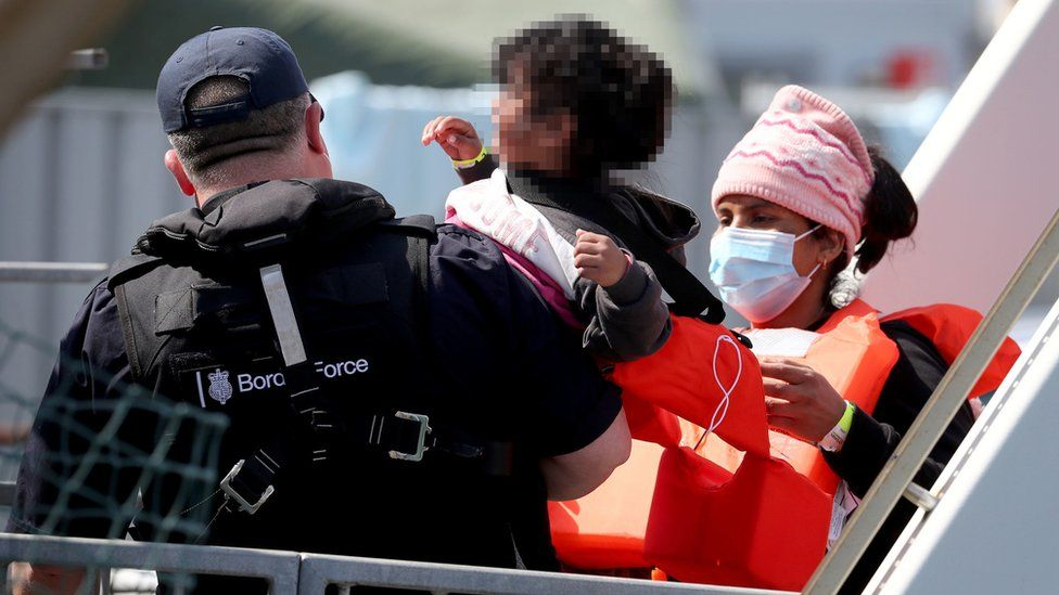 A group of migrants, including children, are brought to Dover on Thursday 3 June