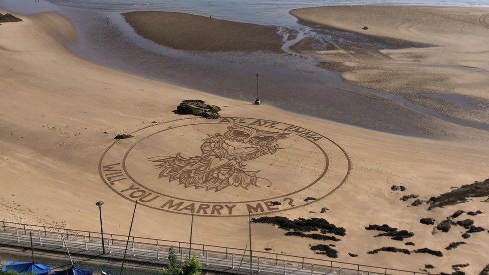 A sand engraving proposal on Tenby beach