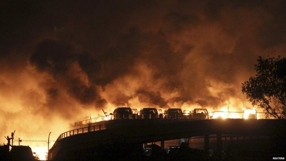 Vehicles can be seen burning at Binhai after huge explosions 12/08/2015