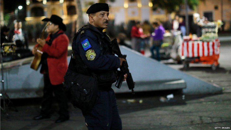 Police patrol the area of Mexico City where gunmen dressed as mariachi musicians killed three people (15 Sept)