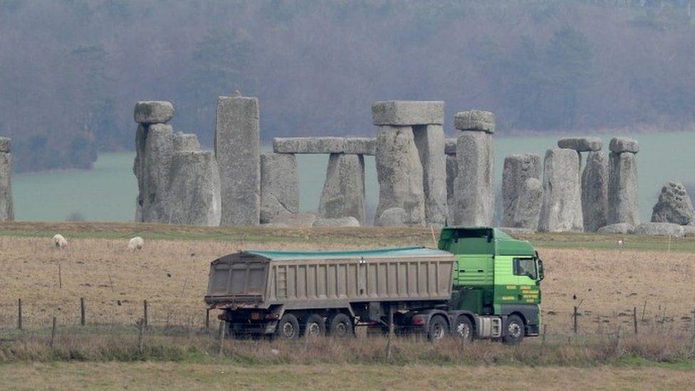 Traffic passes Stonehenge