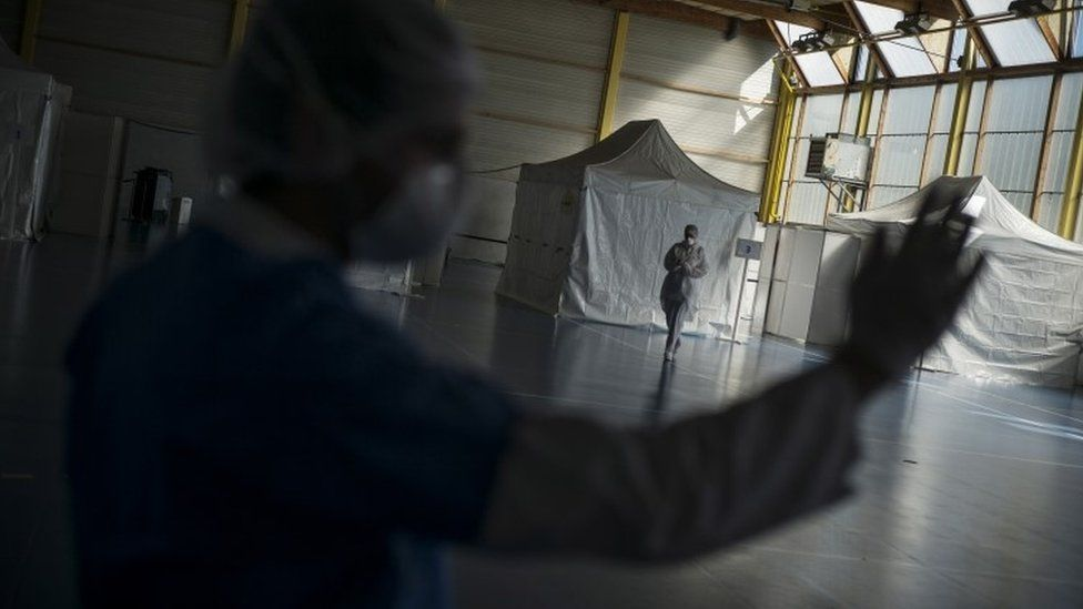A health care worker waits in an emergency centre in France