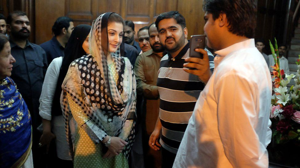 Maryam Nawaz takes a picture with a supporter at a rally in Lahore, Pakistan 9 September 2017