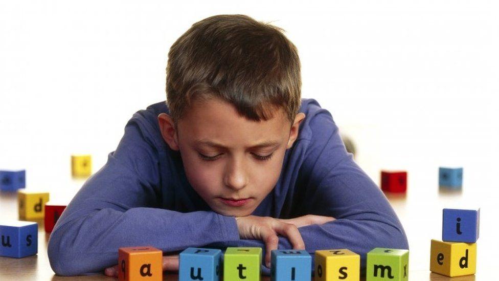 Boy spelling autism