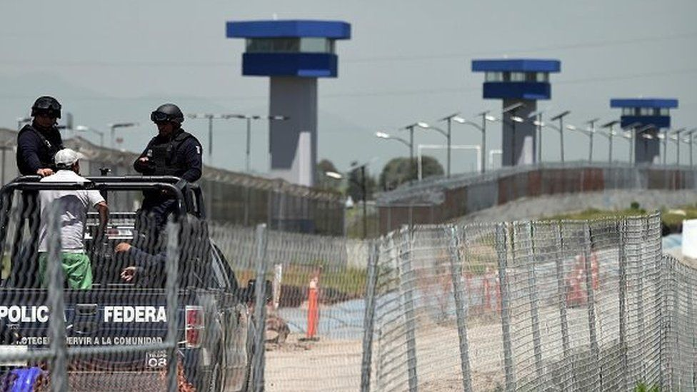 Federal Police officers patrol the perimeter of the Altiplano prison in Almoloya de Juarez, Mexico, on 13 July, 2015.