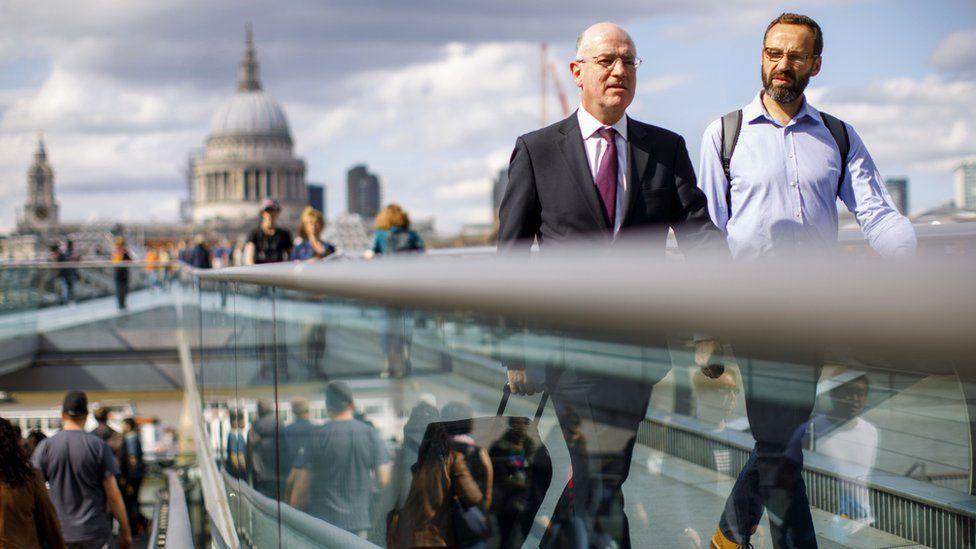 Commuters on London's Millennium Bridge