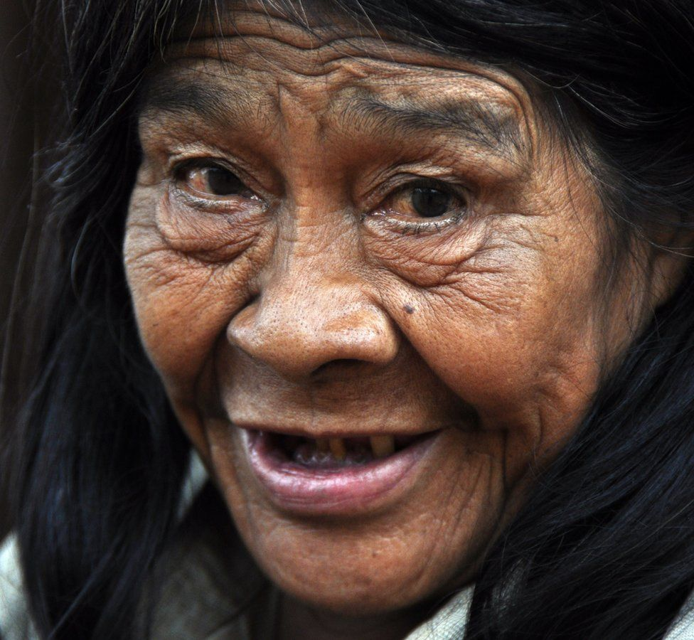 An elderly Ache woman, photographed in 2014