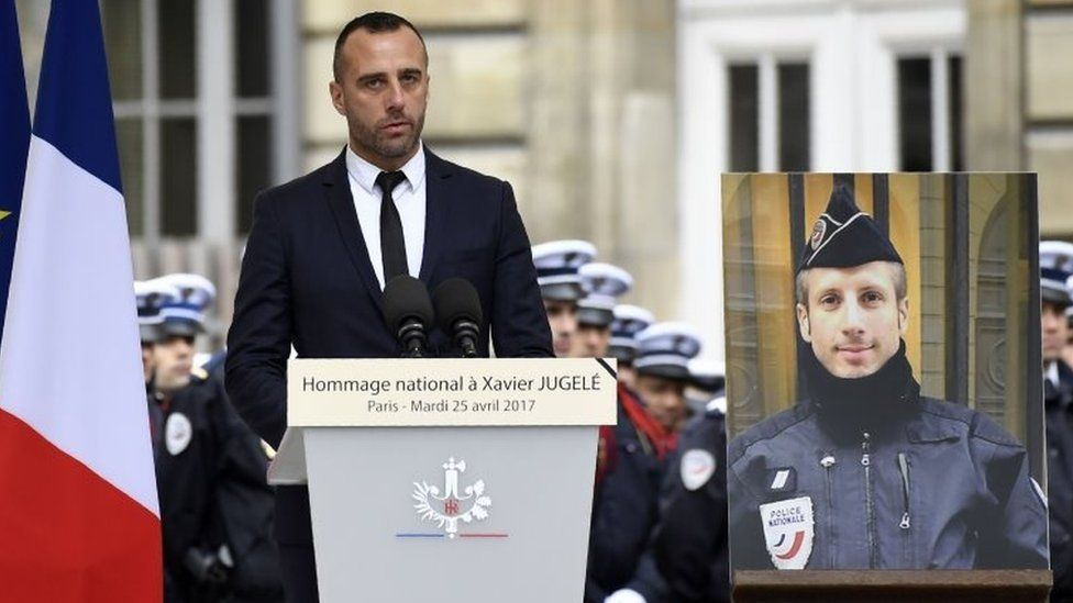 Etienne Cardiles pays tribute to his slain partner Xavier Jugelé (pictured, right) at a ceremony in Paris. Photo: 25 April 2017