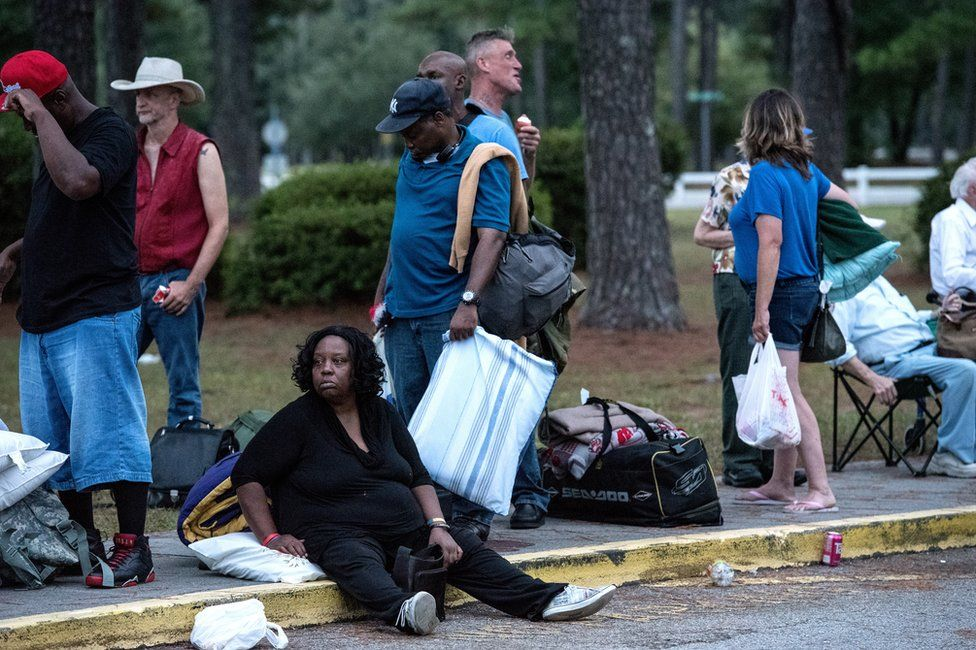 People evacuate ahead of the forecasted landfall of Hurricane Florence as they seek shelter at Emma B Trask Middle School in Wilmington, North Carolina, USA, 11 September 2018