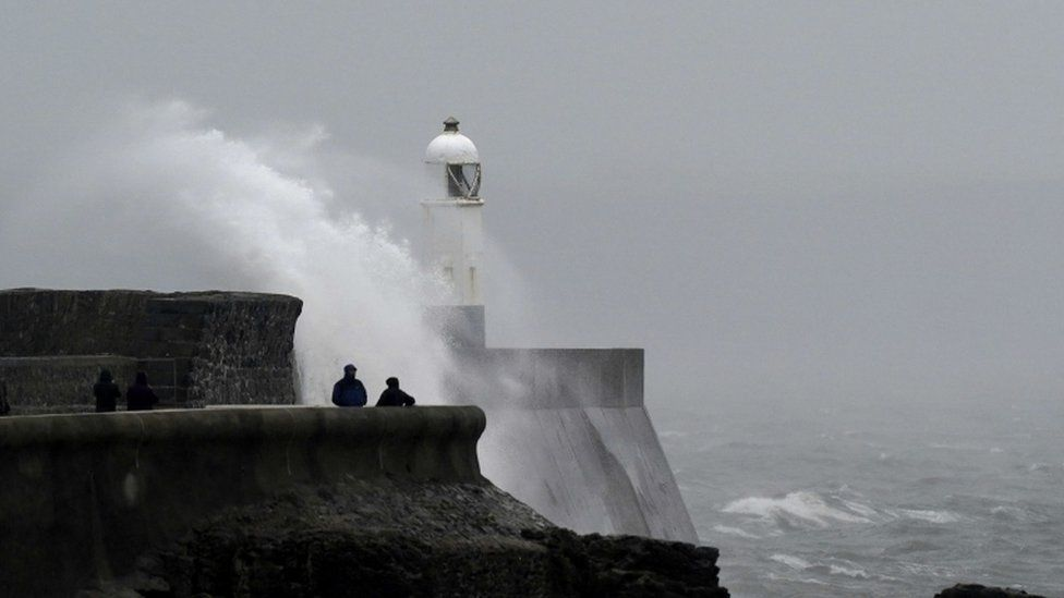 People watch the waves in Porthcawl