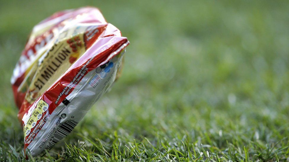 Crisp packet on football pitch
