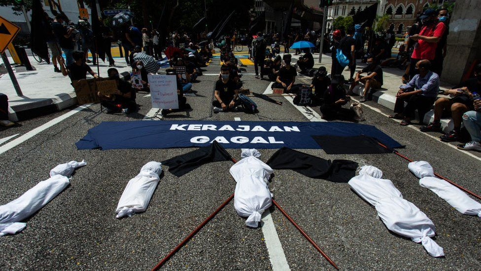 Citizens in Malaysia protested in front of fake corpses to symbolise high number of deaths