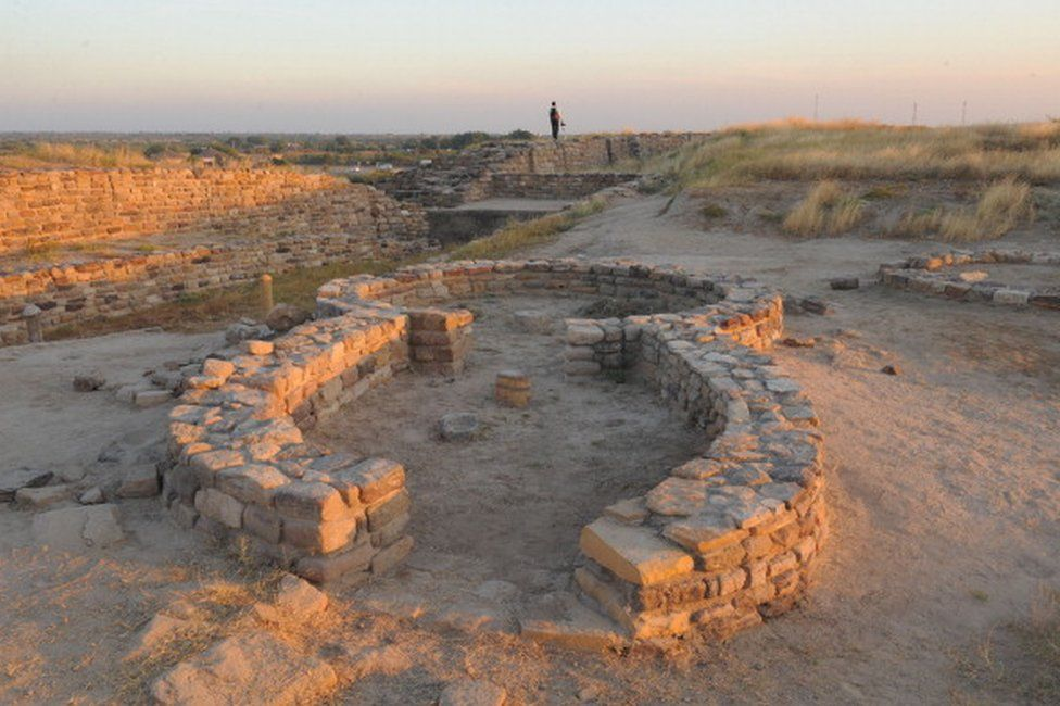 A tourist explores the ancient Dholavira archaelogical site in Kachchh district in Gujarat state on December 18, 2011