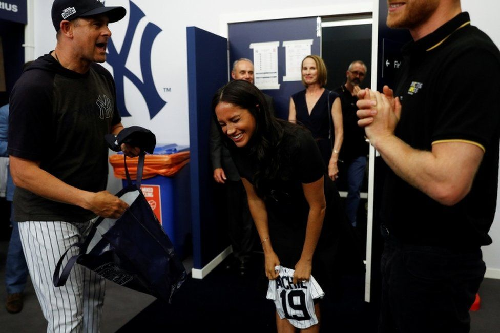 Meghan is all laughs as manager of the New York Yankees, Aaron Boone, presented her with a gift for Archie