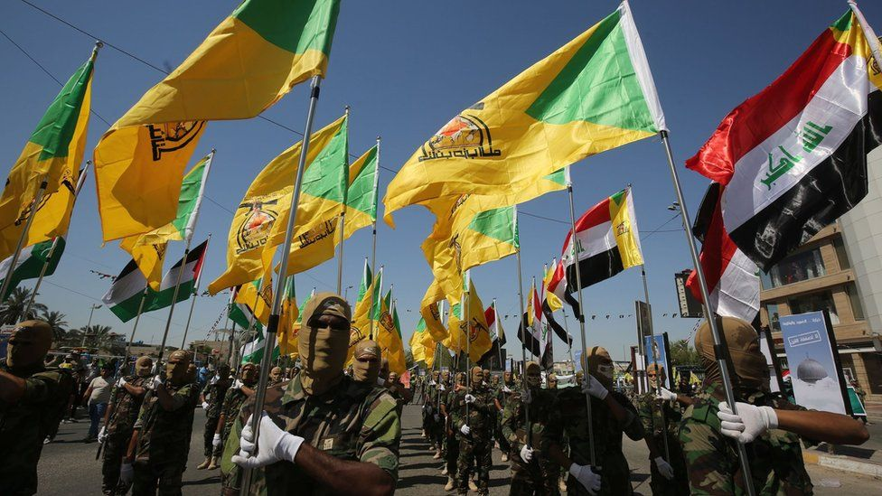 Fighters from the Iran-backed militia Kataib Hezbollah parade through Baghdad, Iraq (31 May 2019)