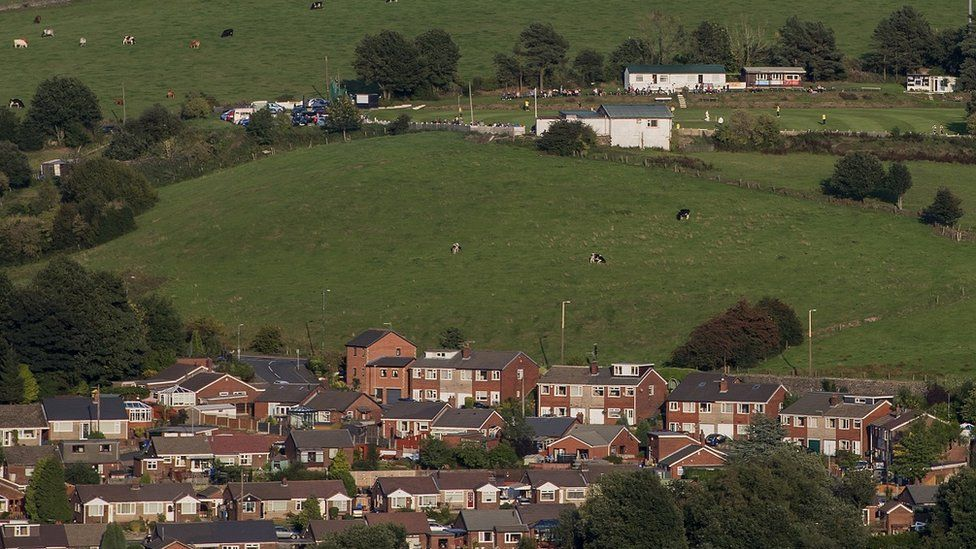 housing estate near Pennines moorland