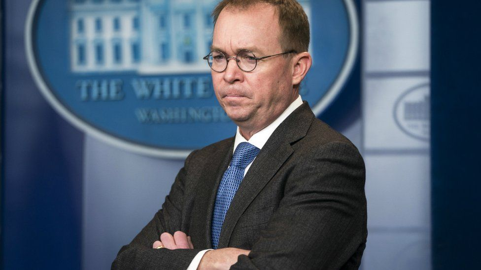 Director of the Office of Management and Budget Mick Mulvaney outside the West Wing of the White House 19 January 2018