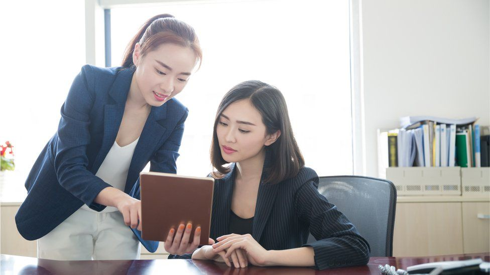 female workers in suits