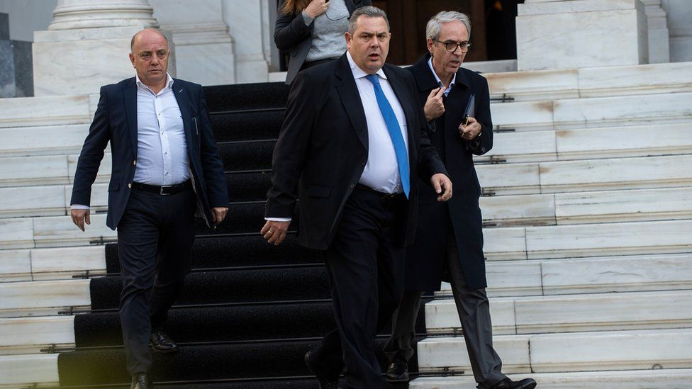 Panos Kammenos (centre) leaves the Maximos Mansion after a meeting with Greek Prime Minister Alexis Tsipras in Athens on January 13, 2019