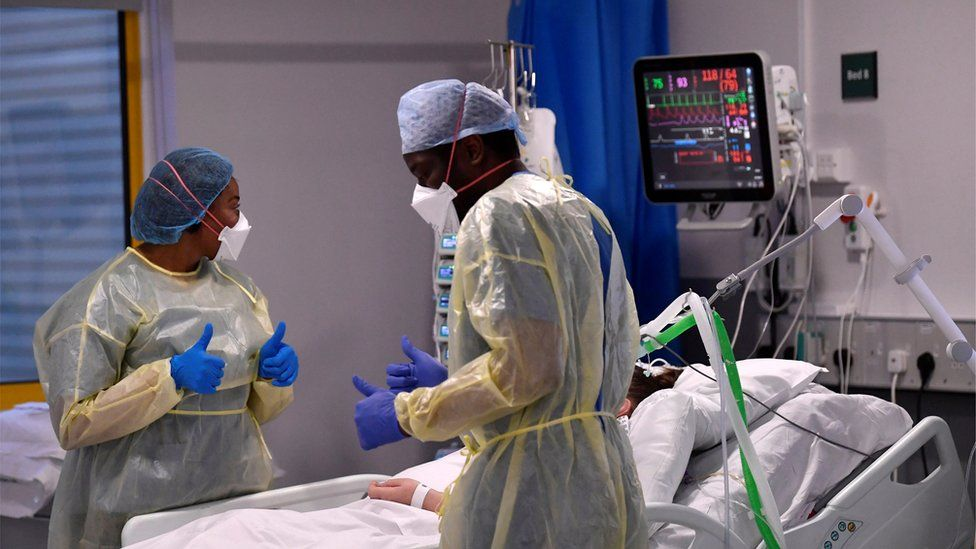 Nurses react as they treat a Covid-19 patient in the ICU (Intensive Care Unit) at Milton Keynes University Hospital in April 2021