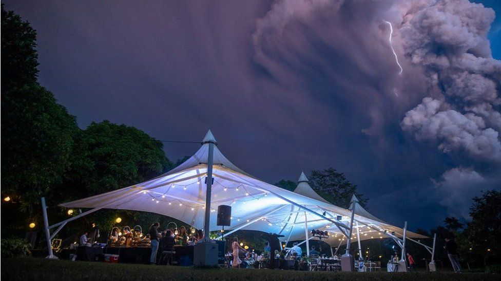 Marquee with volcano and lightning in the background