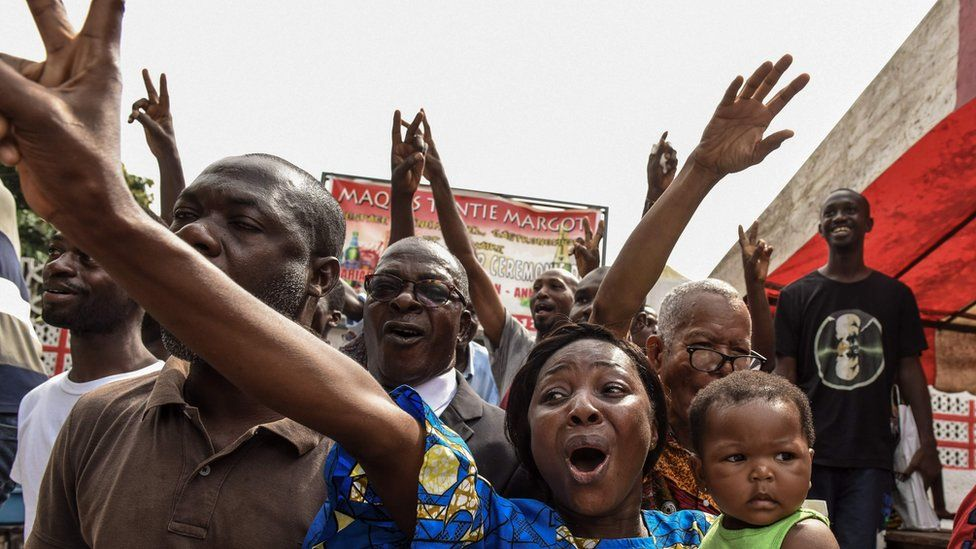 People in Abidjan celebrate after hearing of Mr Gbagbo's acquittal