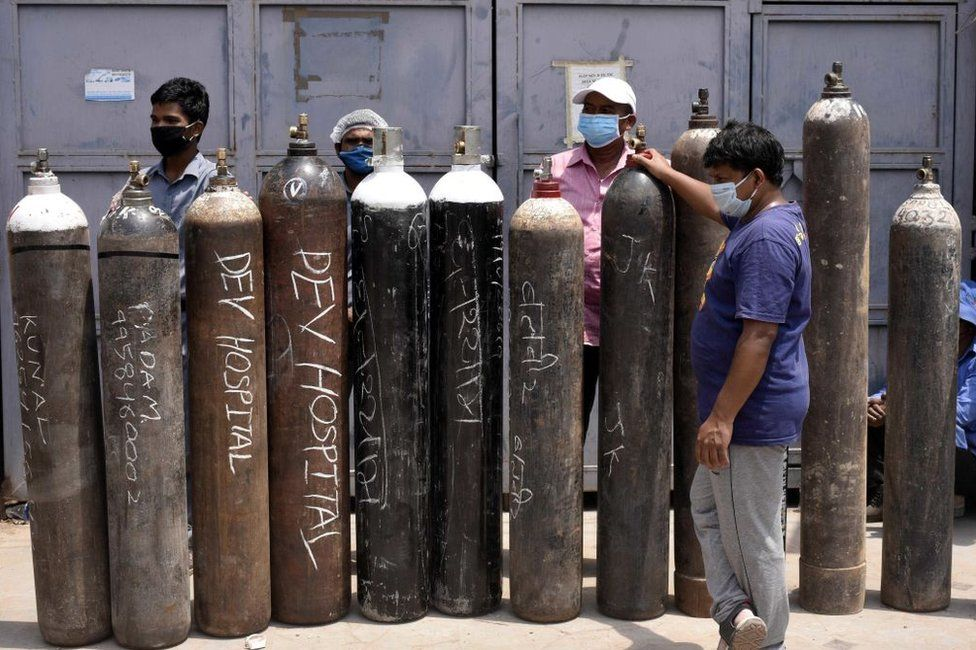 Family members of Covid-19 infected people in a queue with empty oxygen cylinders outside a filling centre at Sector 14 on April 29, 2021 in Gurugram, India.