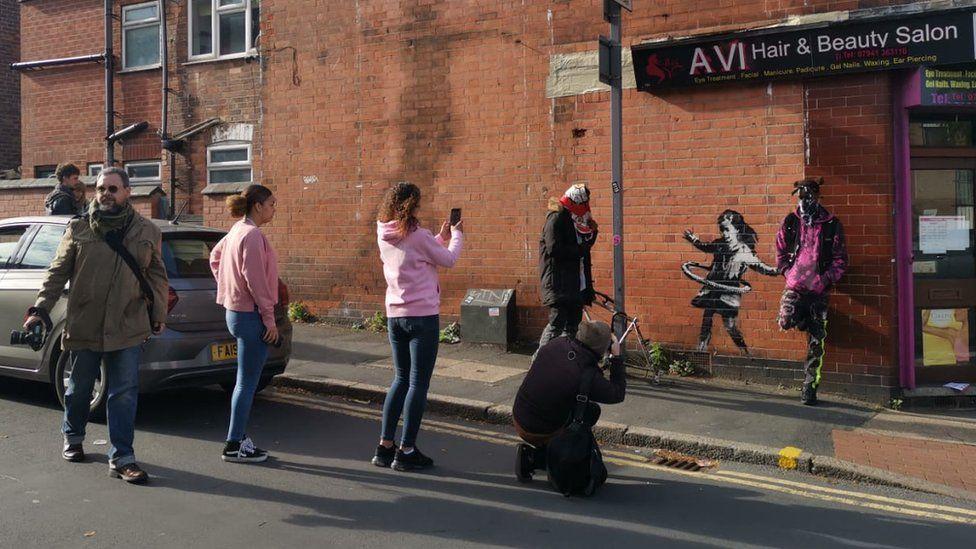 People visiting street art
