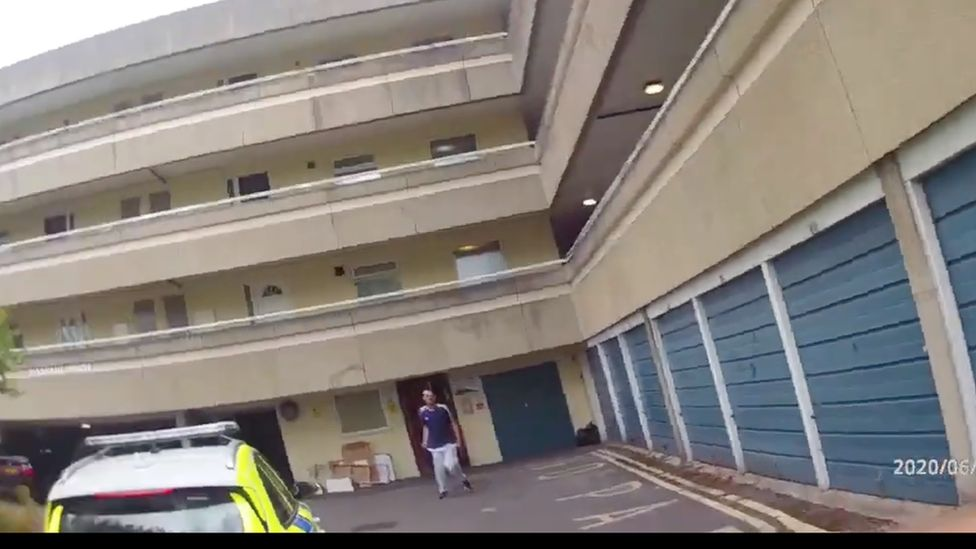 Police being approached by man with knives