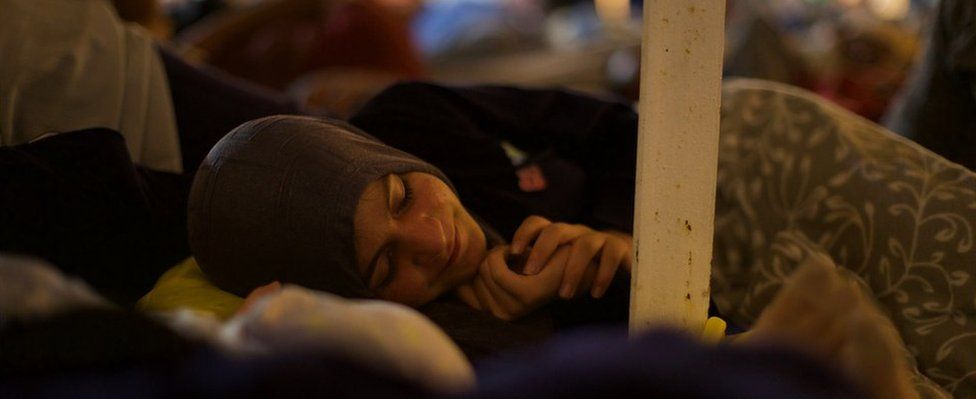 A woman sleeps on board the Vos Prudence